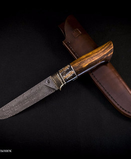 "The ""Iron Tooth"" knife by Alexander Martynyuk (Emfitemzis) blade is a mosaic damascus, in the RK ShKh15 + U10 the handle is bronze, cupronickel, stab. Mammoth tooth, Ironwood."