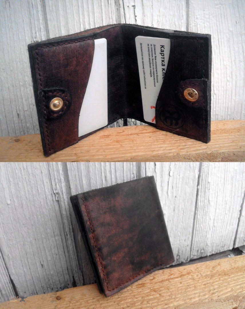 "dark leather wallet on the button by workshop ""Aries and Taurus"""